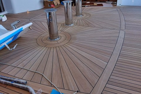 Mosaics in teak deck on super yacht by Duca Solutions