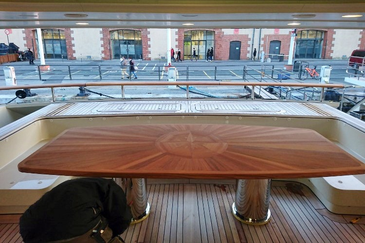 Teak inox table for a super yacht by Duca Solutions