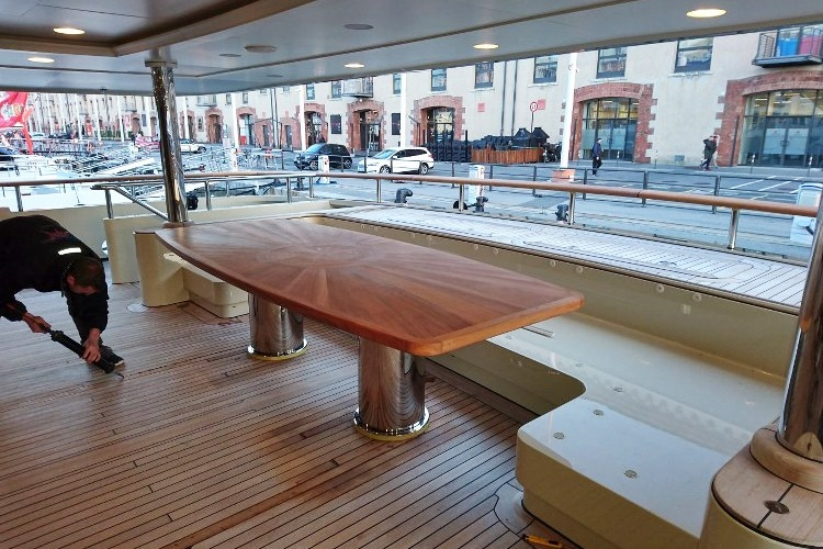 Exterior teak deck table for a motor yacht Duca Solutions