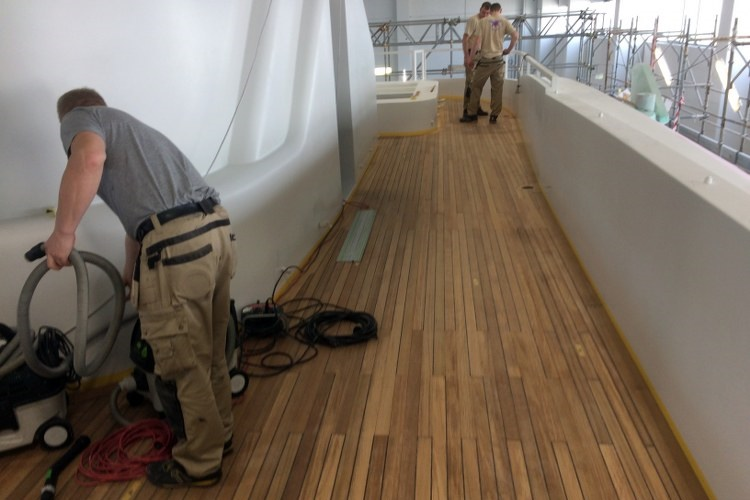 Teak deck on a motor yacht by Duca Solutions