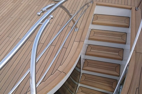 Teak deck and stairs on a mega yacht by Duca Solutions