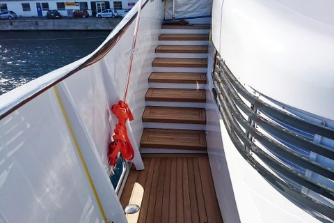 Teak deck covering on yacht by Duca Solutions