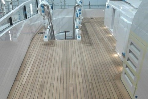 Teak deck fitting on a motor yacht by Duca Solutions