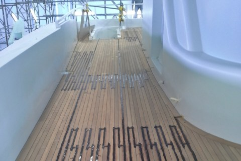 Vacuum gluing teak deck panels on mega yacht by Duca Solutions